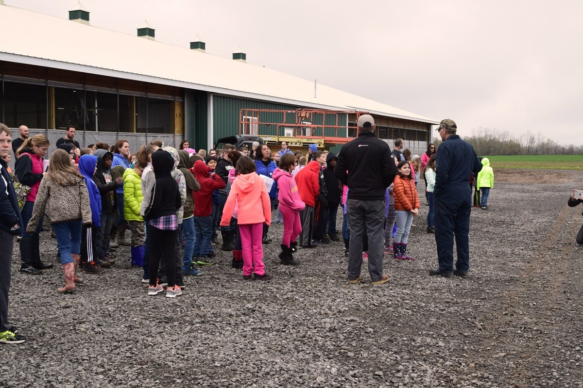 Post Farms with a group of fourth grade students learning about dairy farming and robotics. They are the future of our workforce.